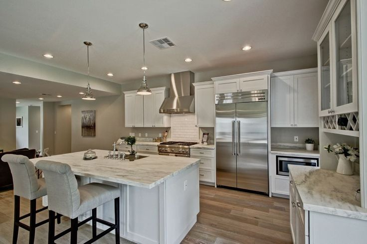Traditional Kitchen with L-shaped, Breakfast bar, Flat panel cabinets, Complex marble counters, Kitchen island, Flush