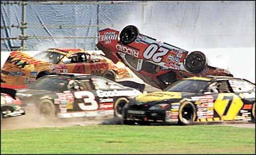 This is from the 2001 Daytona 500, but this happens every year because of restrictor plate racing. Tony Stewart,  upside down, was at the time driving the #20 for Joe Gibbs Racing.