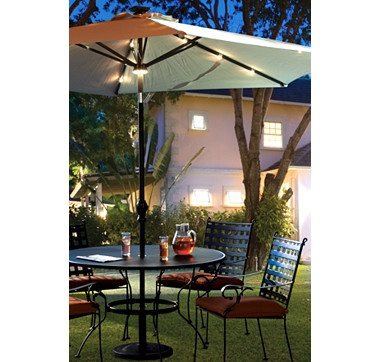 Illuminate your seating area with this Crank & Tilt Patio Umbrella with 26 Solar LED Lights