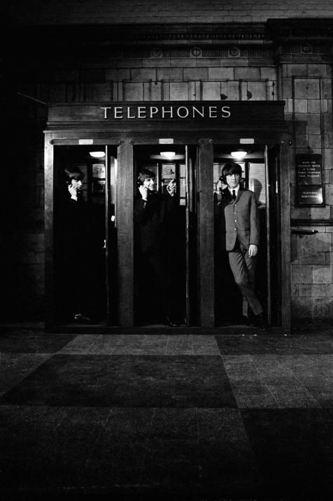 """In telephone booths; the opening scene for the film """"A Hard Day's Night"""" - The Beatles"""