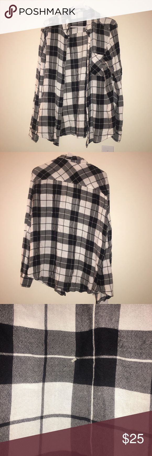 Black and white flannel Size large black and white flannel from garage slight pull in the fabric as shown in the pictures Garage Tops Button Down Shirts