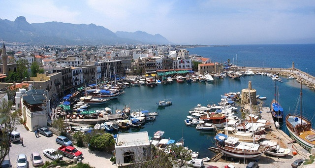 Kyrenia's Old Harbour (Cyprus). 'With the romantic silhouette of the  mountains providing the backdrop,  the slow pace of modern life in Northern Cyprus doesn't get any more idyllic than by Kyrenia's U-shaped Old Harbour.' http://www.lonelyplanet.com/cyprus/north-cyprus/girne-kyrenia