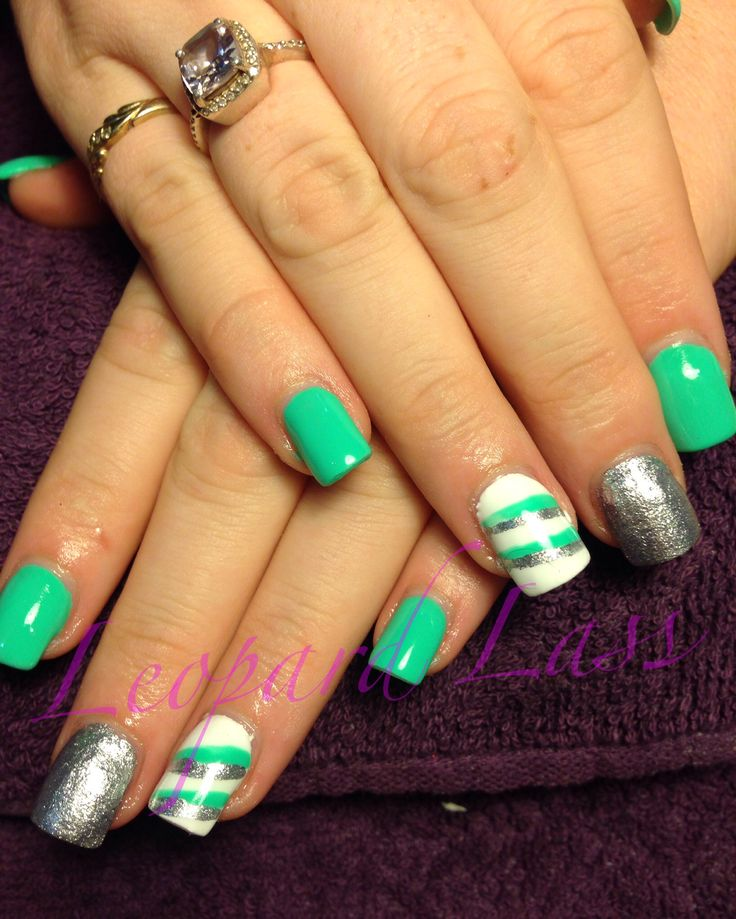 Mint green acrylic nails with silver and white striped feature nails