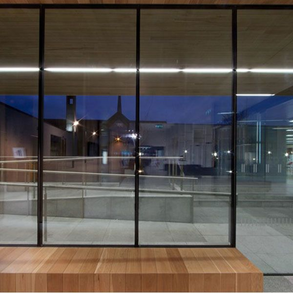 The area between the road and the oriel windows is landscaped to provide a buffer zone with seating