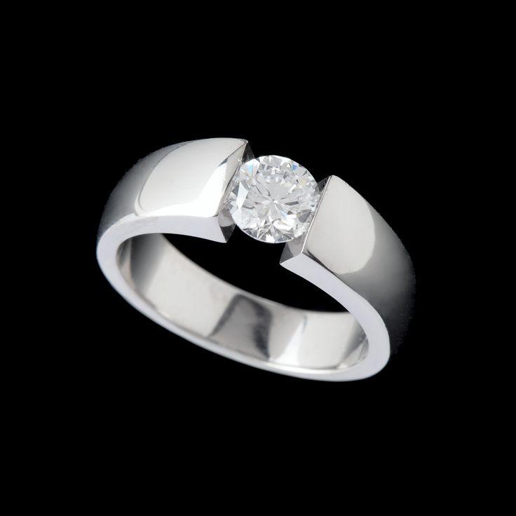 Platinum tension set diamond ring