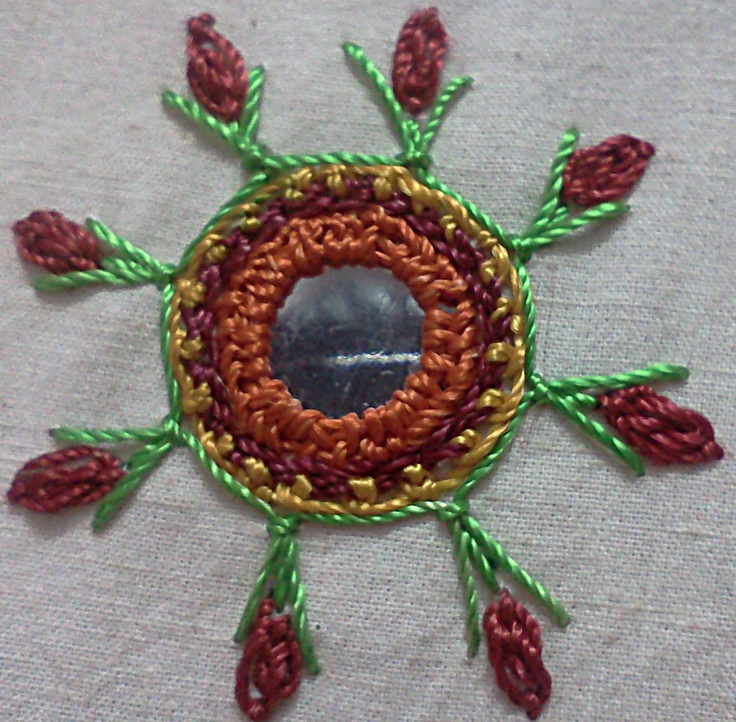 Mirror is surrounded by oyster flowers hand embroidery