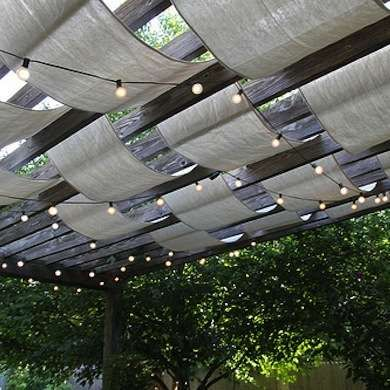 Create with Canvas If your deck or patio is partially covered, drape lengths of fabric or canvas between the joists to create shade. Space out the pieces of fabric for a more transparent look, and add lights to illuminate the space at night.