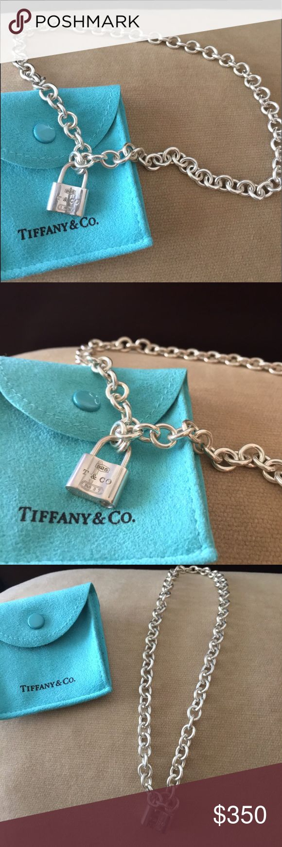 """NWOT Tiffany & Co. Sterling Padlock Necklace! Gorgeous sterling silver 1837 padlock necklace by Tiffany & Co. Never worn, comes with Tiffany pouch and protective pouch for padlock. 16"""" in length. Perfect for a gift or to add to your own collection! This unique design has a working padlock that acts as the clasp for the necklace. Tiffany & Co. Jewelry Necklaces"""
