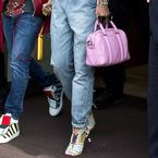 Rihanna wears Topshop dungarees, pink Givenchy bag and Sophia Webster heels
