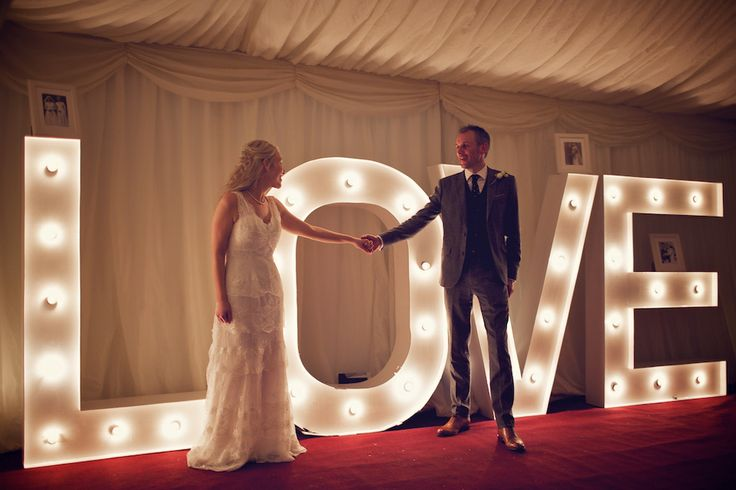 Houston by Cymbeline  www.mirrormirror.uk.com Light up letters spelling out 'LOVE' | Photography by http://www.weddingsvintage.com/photography/