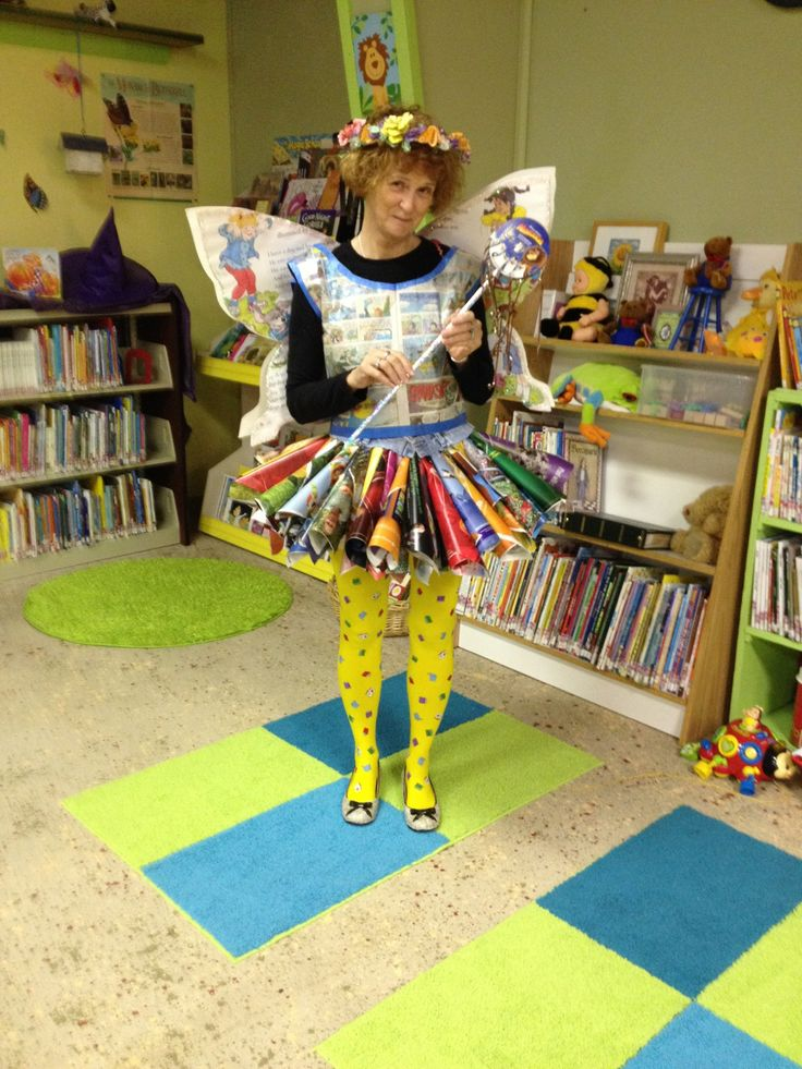 The Library Fairy--this was such a fun costume to make: Skirt: magazine cones hot glued to old jeans waistband, Vest: newspaper comics, Wings: a big book, Head Piece: flowers made from water-colored book pages with VHS tape ribbons coming down the back, Shoes: covered with dictionary pages, Wand: DVDs & audio cassette ribbons