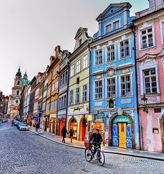 Colorful #Prague. Notice the different architectural styles on the stretch of buildings. www.ebiketoursprague.com