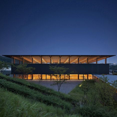 Huge clerestory windows reveal the exposed timber frame of this school sports hall in Kobe, Japan.