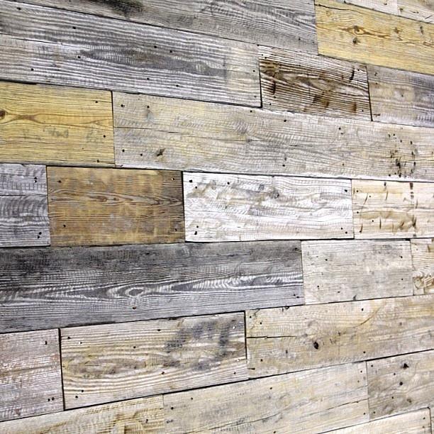 Wall using reclaimed wood. Planks USA.