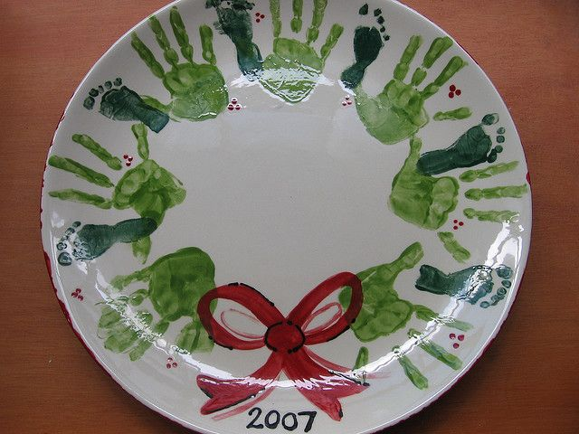 Next great Danie...your babies footprints with Carter's handprints! Grandparent gift - handprint wreaths but on a plate!