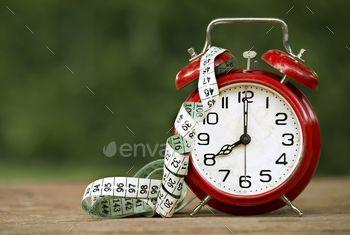 Retro alarm clock and a tape measure