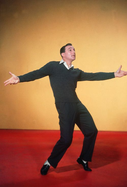 Gene Kelly...Gotta Dance  (But I've gotta say, this pose reminds me a little of SNL's Ed Grimly .  Where is his triangle?  By the way, Love Gene Kelly!