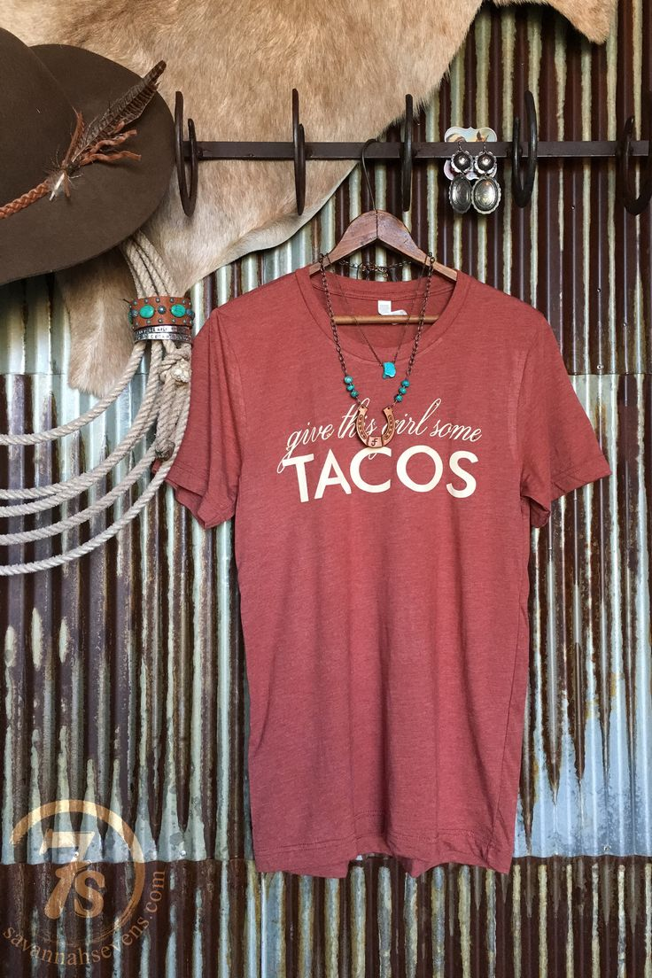 """- """"Give this girl some tacos"""" graphic t-shirt - Terracotta tri-blend with ivory graphic - Super soft lightweight - Unisex - Fits true to size - Shown styled with the Staylee Necklace, Horseshoe Bay Ne"""