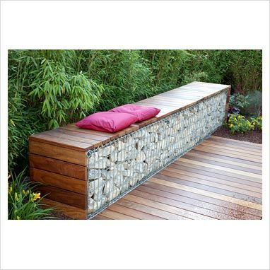 GAP Photos - Garden & Plant Picture Library - Bench made from wood and gabions backed by Fargesia murielae - Bamboo hedge - GAP Photos - Specialising in horticultural photography