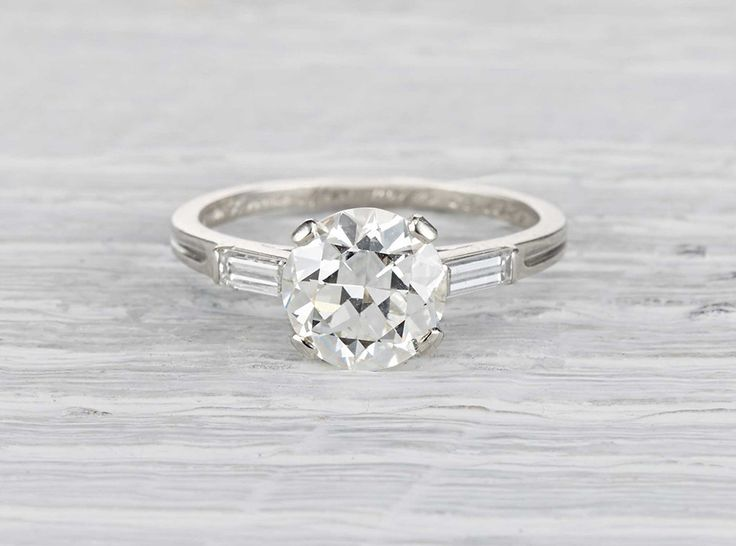 Antique Art Deco Tiffany & Co. engagement ring made in platinum and centered with a GIA certified 2.03 carat old European cut diamond with I color and VVS2 clarity. Accented with two baguette cut diamonds. Signed Tiffany & Co. Circa 1920.