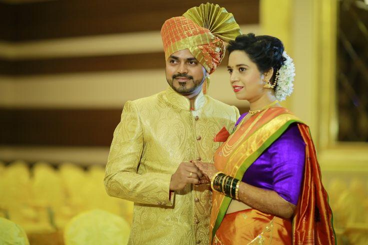 Groom with his Bride - marathi wedding -candid wedding photography- orange nauvari - gajra- pheta