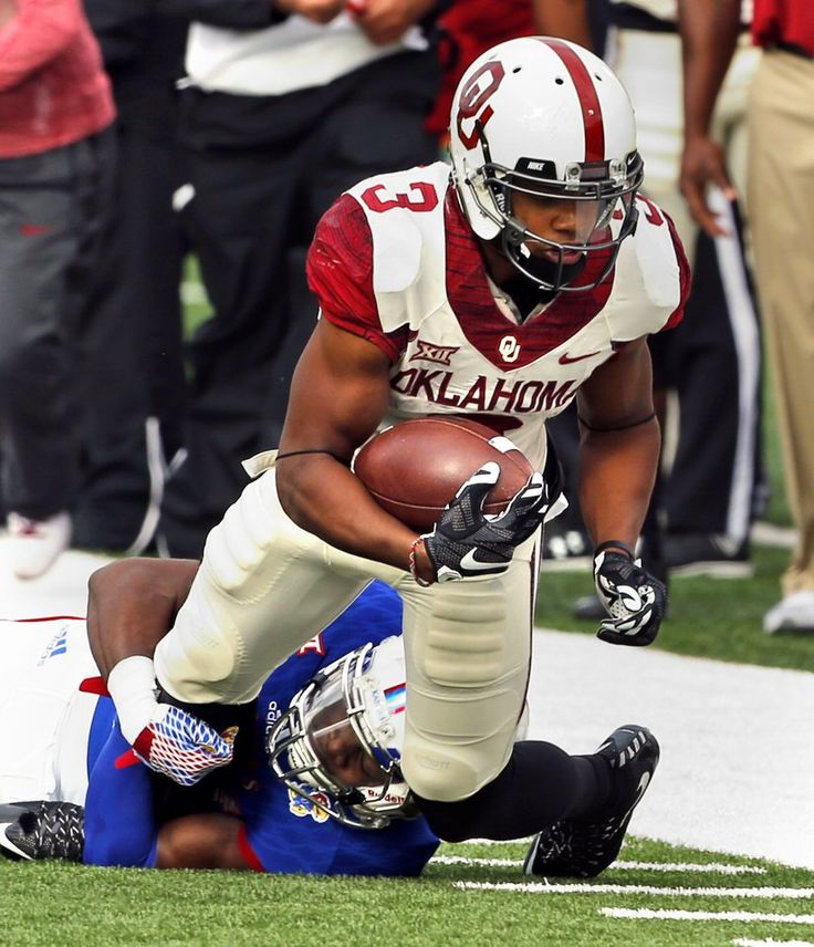 Oklahoma's Sterling Shepard (3) stretches for more yards during a college football game between the University of Oklahoma Sooners (OU) and the Kansas Jayhawks  at Memorial Stadium in Lawrence, Kansas, on Saturday, Oct. 31, 2015. Photo by Steve Sisney, The Oklahoman