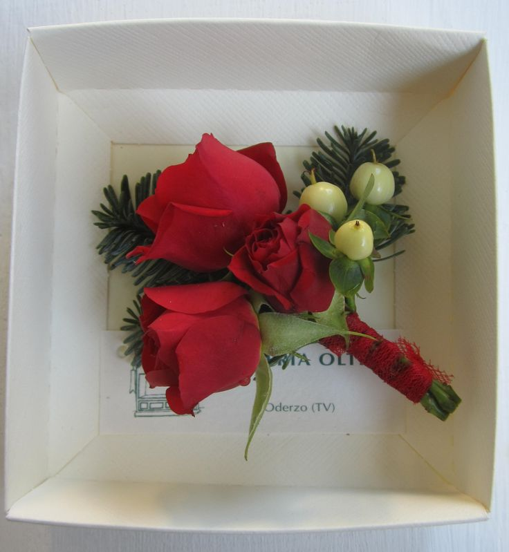 Fioreria Oltre/ Red spray rose and hypericum boutonniere