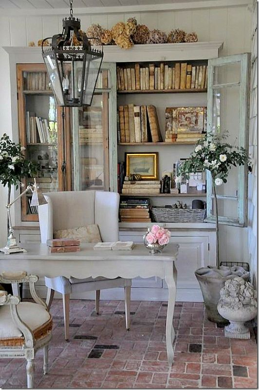 Cottage Chic - Design Chic, shabby chic home ideas, french country looking home, dried hydrangeas, light blue bookcases, vintage book display ideas, lantern over desk