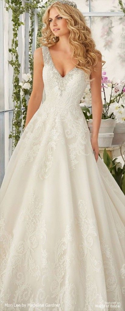 Mori Lee by Madeline Gardner Spring 2016 Wedding Dress.Diamante Beading Edges the Tulle Ball Gown Decorated with Wispy, Embroidered Lace Appliques and Deep Scalloped Edging