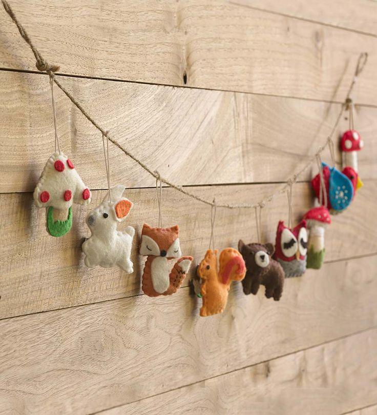Woodland Animal Garland These wool felt critters add a pop of color and delight to any room or woodland theme party.