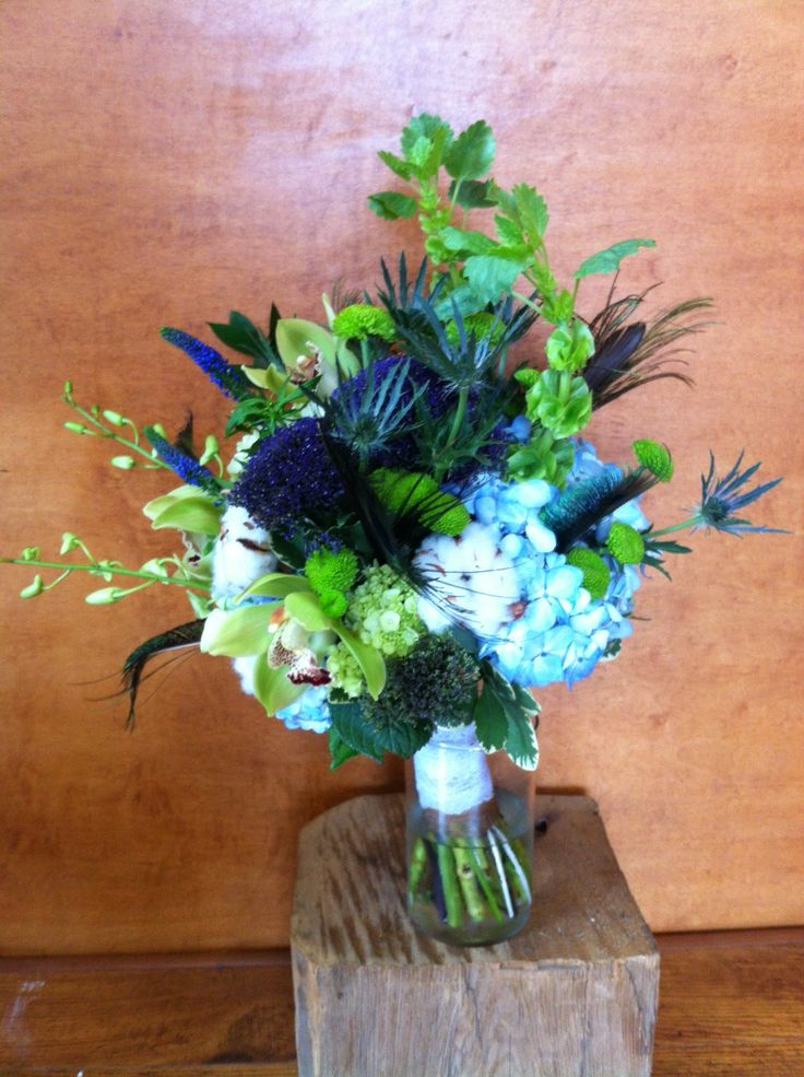 A Peacock inspired bouquet designed by Olive Lane. Sabrina  brought in the peacock feathers for us to use in her Bridal bouquet.