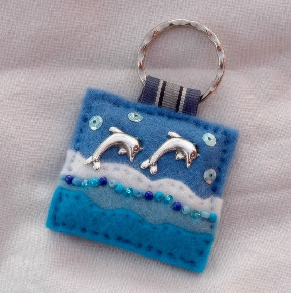 I want this =P Hand sewn felt and dolphin charm key ring - £6.00 + postage. www.elliestreasures.co.uk