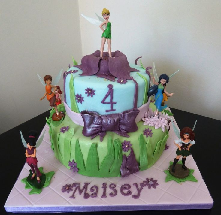 I just love these mixed cake and plastic figure birthday cakes. Its a win-win. Eat the cake AND play with the toys. Result!   Two Tier Fairy Pirate Cake