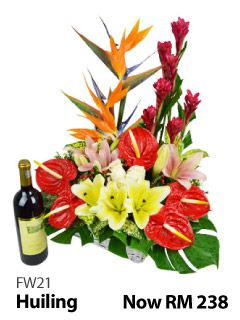 Basket of mixed flowers & 1 Bottle of Italy Great Ocean (Red Wine).