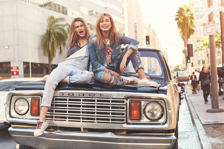 Immy Waterhouse wears overalls and Hailey Baldwin wears denim jacket and distressed pants from Tommy Hilfiger 2016 campaign