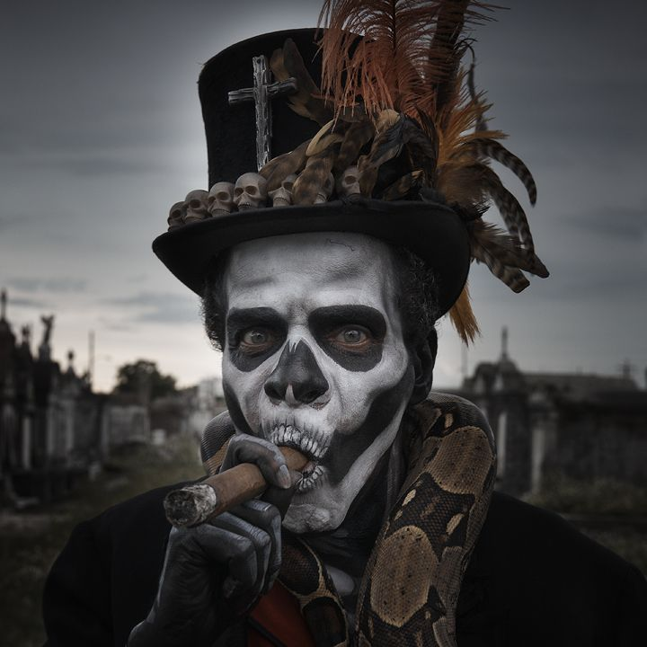 Baron Samedi is a Loa of the dead and a fun charracter in this book. He sure does like his top hats, cigars, and rum. :)