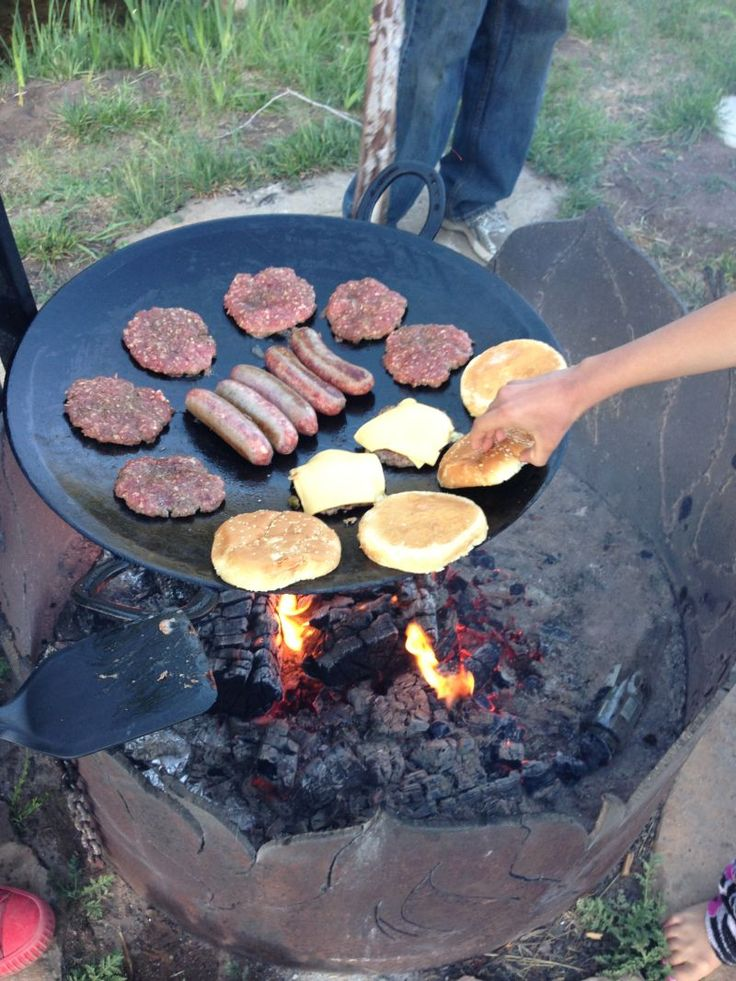 Burgers  on a discada with welded on horse shoe handles.