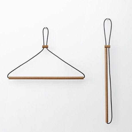 Whenever I need to travel with a clothes hanger, I use this awful plastic thing: Beyond the fact that it's flat and that the hook folds down, there really isn't much design effort making this a travel-friendly item. With its broad outline it's awkward to pack, and I'm always worried