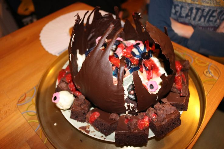 Halloween pot cake with chocolate brownie, cake pop eyes, cream and candies