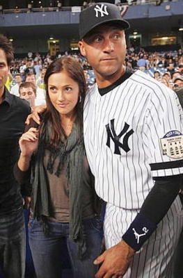 With girlfriend Minka Kelly after a game.