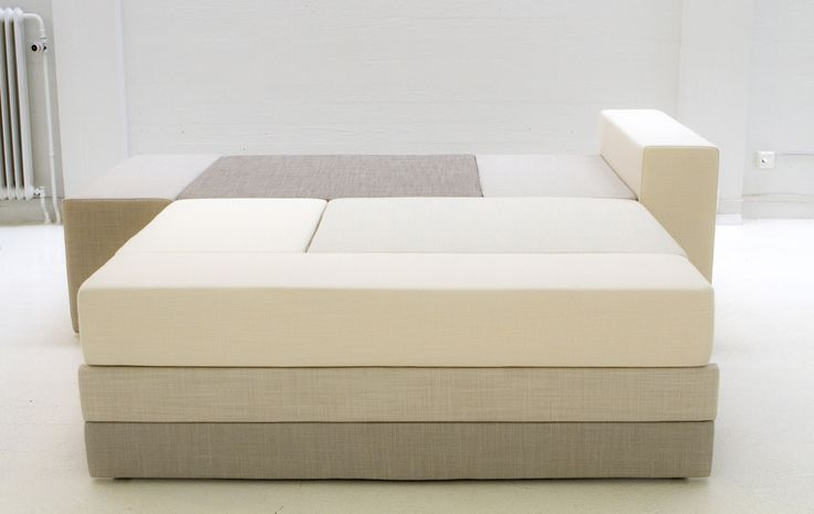 Hanasaari 3-seater sofabed by Ateljé Sotamaa. Shades of white. Stage 3 / bed.