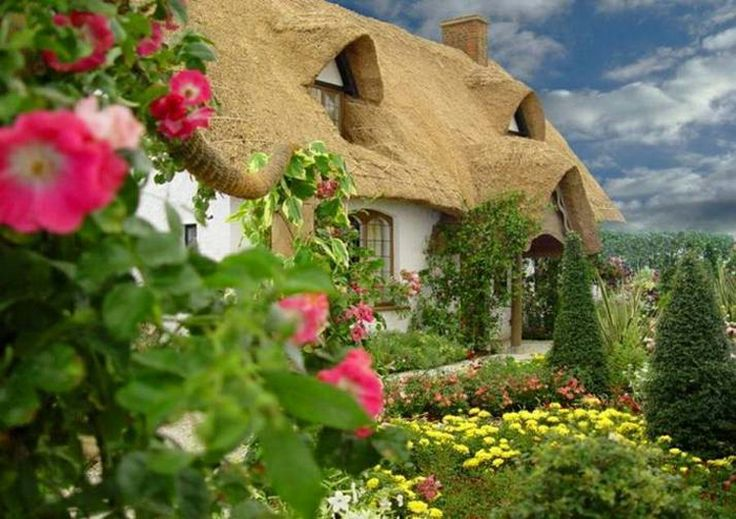 thatched cottage is a beautiful adornment to the English countryside