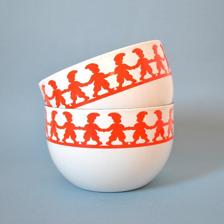 Vintage white enamel bowls decorated with red Tonttus (home gnomes) designed by Kaj Franck for Finel