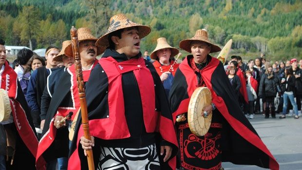 Four hundred members of the Nisga'a Ts'amiks, many of whom have not stepped foot in the Nass Valley since they were taken away to residential schools, march towards the Nisga'a Museum in Greenville.