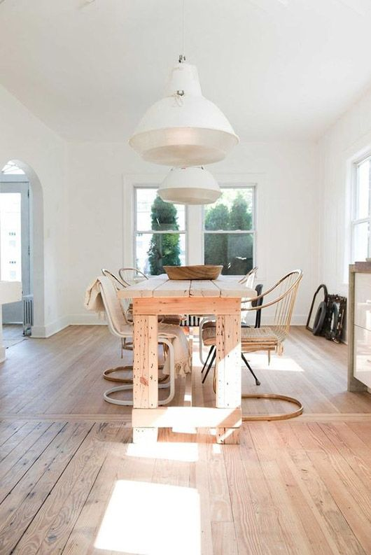 natural wood dining table and chrome chairs. industrial white pendant lights