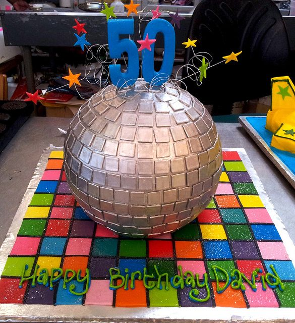 3D Disco ball shaped Wicked Chocolate cake, decorated with multi-colour disco dance floor & 3D blue #50 by Charly's Bakery, via Flickr