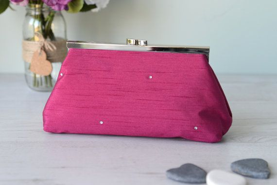 Evening clutch bag purse in hot pink with diamante detail and cotton lining with silver metal kiss-lock straight frame.
