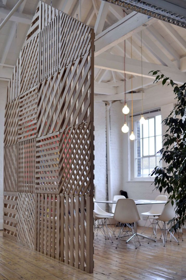 such a cool room divider, made of pallets.