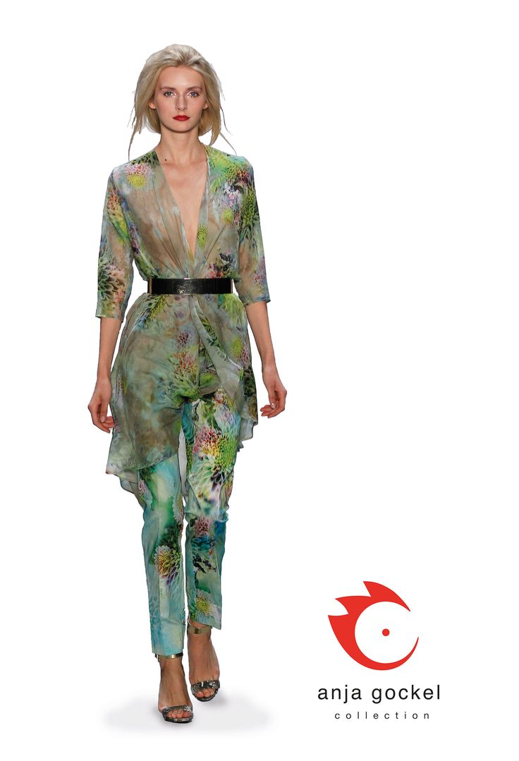 "The wonderful ""Dhalia"" print in two interpretations combined to one glorious outfit. The classic, elegant Diva trousers worn together with a light floating chiffon long, floating jacket.The waistline is nicely accentuated with a golden belt."