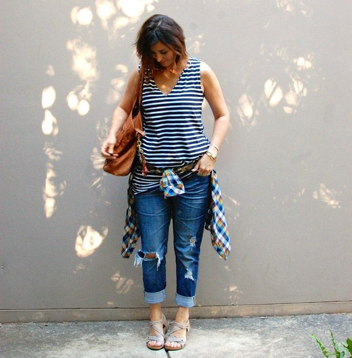 Short Striped dress worn as tee, ripped boyfriends and a plaid shirt and stone sandals. Mixing prints